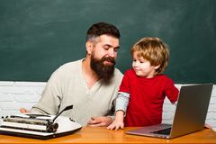 First day in school. Happy family. Copy space. Preschool pupil. Teacher and child. Teacher and kid. Daddy and his little. Son. Chalkboard ready for text. Little royalty free stock photography