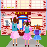 First day of school. Three sisters are arriving at their school, all dressed up and carrying  their backpacks Stock Photos