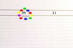 First Day of Spring. Circled in flowers on a calendar page stock photo