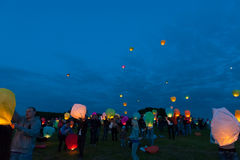 First Day of Summer Festival. MOSCOW - JUNE 1: Young people release floating lanterns during the First Day of Summer Festival, on June 1, 2012 in Moscow. During royalty free stock photography
