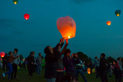 First Day of Summer Festival. MOSCOW - JUNE 1: Young people release floating lanterns during the First Day of Summer Festival, on June 1, 2012 in Moscow. During royalty free stock photo