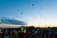First Day of Summer Festival. MOSCOW - JUNE 1: Young people release floating lanterns during the First Day of Summer Festival, on June 1, 2012 in Moscow. During stock photos
