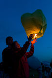 First Day of Summer Festival. MOSCOW - JUNE 1: Young couple release floating lanterns during the First Day of Summer Festival, on June 1, 2012 in Moscow. During stock photos