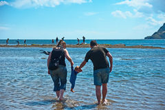 First dip in sea at Robin Hoods Bay Stock Photography