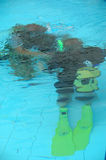 The first dive. A instructor is traning a student how to dive Stock Photo