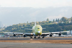 First Dreamlifter cargo plane landing. Seattle, USA September 16, 2006: First specially built DreamLifter, a modified Boeing 747-400, touches down at Boeing Royalty Free Stock Image