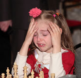 First failure. Child 7 years old at chess competition Royalty Free Stock Photo