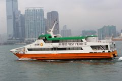 First Ferry speed boat connects Central Island in Hong Kong with the islands Lantau, Lamma, Cheung Chau. First Ferry company operates with fast ferries between Royalty Free Stock Photo