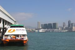 First Ferry speedy water jet for public city transport to the islands in Hongkong, China. First Ferry is a company with various fast speed boat lines between the Stock Photo