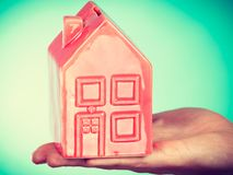 Male hand with little red house. Royalty Free Stock Images