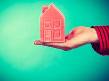 Male hand with little red house. Stock Images