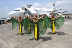 First flight. Dancers performed the dance of the Peacock just prior to the first flight from the airport of Trigana Air, Adi Sumarmo airport Solo, Wednesday (18/ Royalty Free Stock Photo