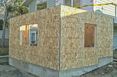 First Floor of Addition. Foundation and first floor of home addition framed and covered with osb (oriented strand board Royalty Free Stock Images
