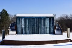 The First Folio Theatre. This is a Winter picture of the iconic First Folio Theater Outdoor Mainstage Venue covered in snow, located on the Mayslake Peabody Royalty Free Stock Photography