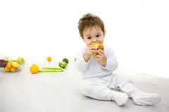 First food of the child. baby surrounded with fruits and vegetables, healthy child nutrition Stock Photos