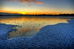 First frost on lake Stock Images