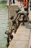 The First Generation, bronze sculpture by the Singapore River Royalty Free Stock Images