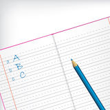 First grade copybook with pencil. First grade copybook with blue pencil and white backdrop Stock Photography
