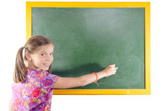 First grade pupil a girl writing on green Royalty Free Stock Photo