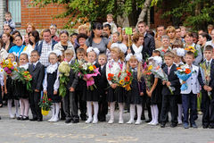 First-grade pupils, teacher and parents. Tyumen Royalty Free Stock Photo