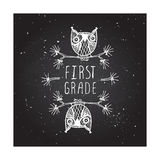 First grade - school poster. First grade. Hand-sketched typographic element with cute little owls on chalkboard background Stock Photography