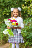First grader with bouquet of flowers smiling happily Royalty Free Stock Photography