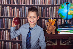 First-grader boy with apple Royalty Free Stock Images