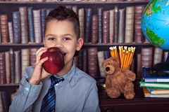 First-grader boy eating apple Royalty Free Stock Photography