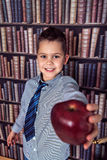 First-grader boy with red apple Stock Photos