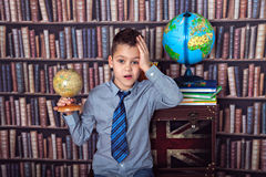 First-grader boy tired of studying Royalty Free Stock Photo