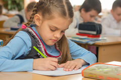 First grader in class writing notebook Royalty Free Stock Photos