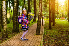First grader, day of knowledge - 1. September. Little first-grader, girl-student goes to school on knowledge day - September First. Student of elementary school Royalty Free Stock Photos