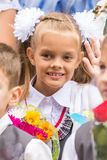 First grader on first of September, the line greeting waving friend Royalty Free Stock Photos