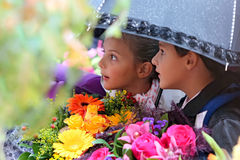 First Grader Girl And Boy Under An Umbrella At School Stock Image