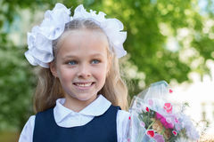 First grader girl with bows Stock Image