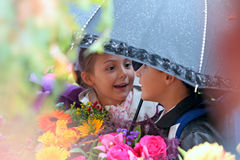 First grader girl and boy under an umbrella at  school Royalty Free Stock Photography