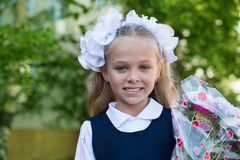 First grader girl with flowers Royalty Free Stock Photography