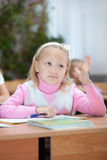 First grader girl puts her hand up stock photo