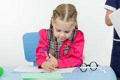 First-grader a lesson at school Royalty Free Stock Photo