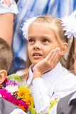 First grader on the line of first of September thinking looking up Stock Photos