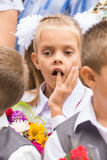 First grader on the line of first of September thinking stuck a finger in his mouth Stock Images