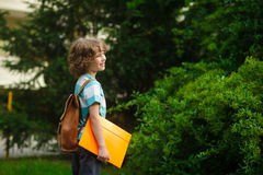 The first grader on a schoolyard. Stock Photo