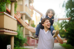 First grader sitting on the shoulders of his father. Royalty Free Stock Photos