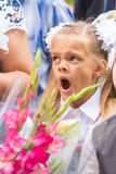 First grader yawning on line first of September Stock Image