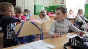 First graders at their desks stock video