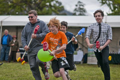 The first heat - 2. MARYSVILLE, VICTORIA, AUSTRALIA - November 2: A group of men and boys compete for first place in a hobby horse race at the Marysville stock image