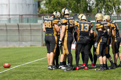 First hit of the game. RUSSIA, TROITSK CITY - JULY 11:  Unidentified players ready to start the game on Russian american football Championship game Spartans vs Royalty Free Stock Image