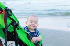 First holiday at sea. Baby with two teeth. Royalty Free Stock Images