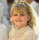 First holy communion. A blond girl smiling at the camera, celebrating her first holy communion. Positive feeling Stock Photos