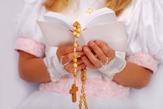 The first holy communion. Hands of prying girl going to the first holy communion Stock Images